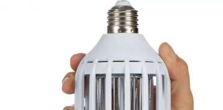 A person is holding a Zapper light bulb